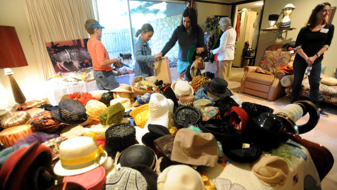 Hats cover a bed at the estate sale at the home of longtime Reporter-News columnist Roy Helen Ackers, who died in February at 95.