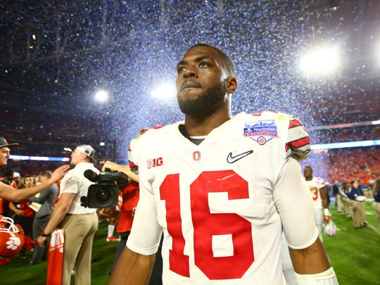 Dec 31, 2016; Glendale, AZ, USA; Ohio State Buckeyes quarterback J.T. Barrett (16) walks off the field after the 2016 CFP semifinal against the Clemson Tigers at University of Phoenix Stadium. The Clemson Tigers wont 31-0. Mandatory Credit: Mark J. Rebilas-USA TODAY Sports