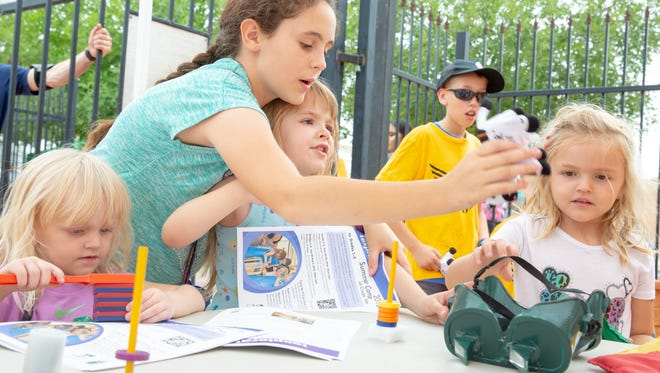 Pictured from left, Lily Ball, 3; Kaitlin Fitzherbert, 11; Audrey Fitzherbert, 5; and Isabella Ball, 5, discover magnetic properties at the Museum of Nature and Science booth on Saturday, June 9, 2018, during the Las Cruces Museum System Kick Off in the museum courtyard outside of Branigan Cultural Center. Pictured in the background is Peyton Larcher, 11.