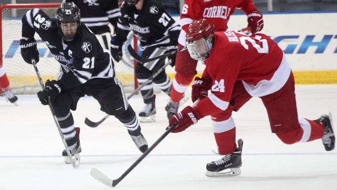 Cornell's Ryan Bliss, right, and Providence's Kevin Rooney battle for possession.