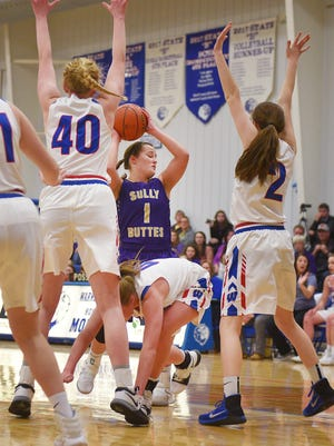 Sully Buttes' Rachel Guthmiller goes against Warner defense during the game Saturday, Jan. 28, in Warner.