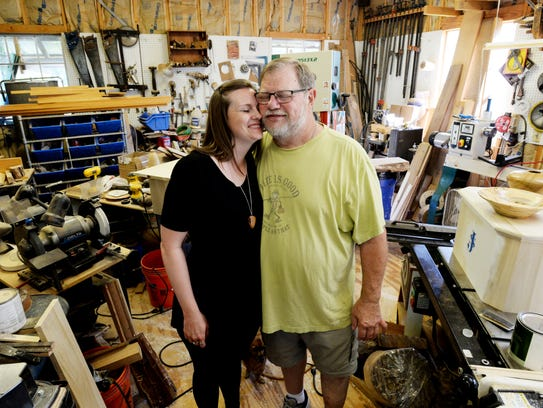 Michael Gable and his daughter Kimberly Gable. He passed on his passion and talent for carving wood sculptures, such as hummingbirds, to his daughter.