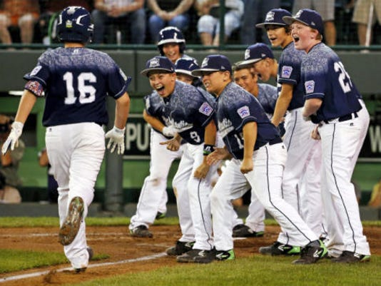 Kaden Peifer, of Red Land Little League, is greeted by teammates after hitting a three-run home run off Webb City, Missouri's Devrin Weathers during the second inning of a baseball game in United States bracket play at the Little League World Series tournament in Williamsport on Friday.