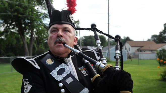Shane Ronan practices playing the bagpipes Monday at his home in Lancaster. Ronan plays the bagpipes at various events around Fairfield County and the surrounding area.