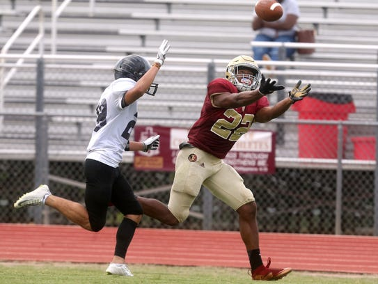 Riverdale's Jarek Campbell reaches to catch the football