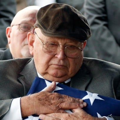 Frank Springs, of Lucedale, hugs the American flag