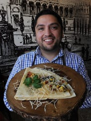 Juan Carlos Ramirez Jr. displays the a la Mexicana crepe at Xielo Artisan Desserts in Oxnard.