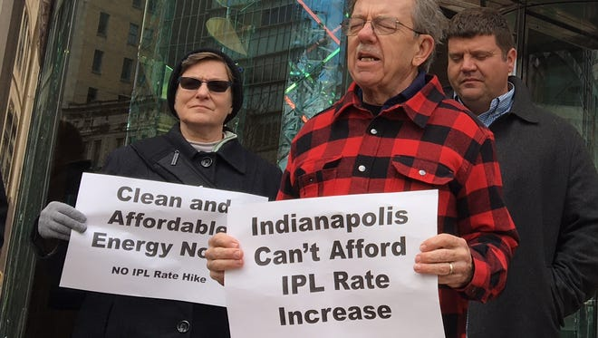 People of faith marched with Hooser Interfaith Power and Light to protest a proposed rate increase by Indianapolis Power & Light.