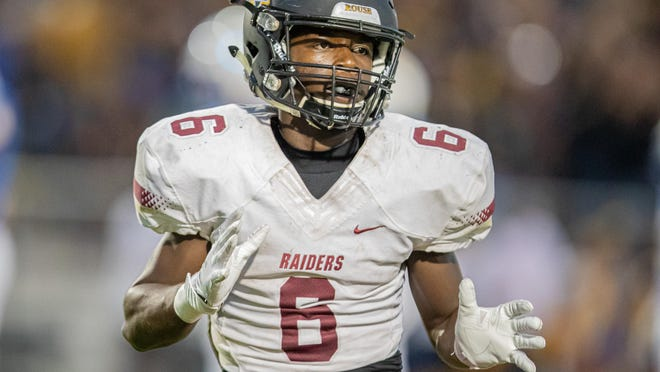 Rouse junior Troy Oliver, playing against Pflugerville last year, spent the first seven years of his life living in Japan. As a pregame ritual he listens to hype music.