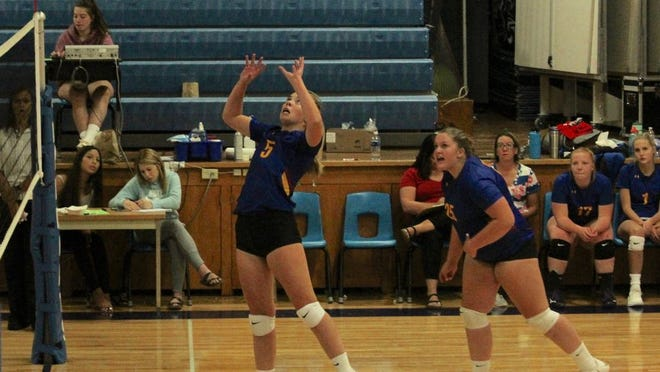 Benson County senior setter Keryn Nelsen sets the ball for a scoring opportunity in a game against TGU on Sept. 8 at Leeds High School. The Wildcats won, 3-0.