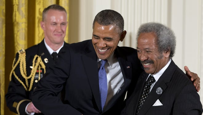 President Barack Obama awards  Allen Toussaint the 2012 National Medal of Arts July 10, 2013 at the White House.