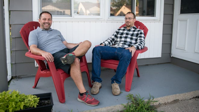 Mike McFall and his husband Jake Cooper at their home in Hazel Park on July 18, 2018.