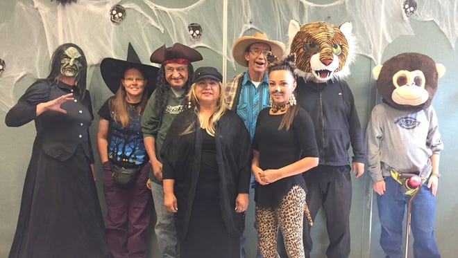 Life Quest celebrated its Halloween with a party at the Silver City Public Library. Above, not in order are Candi Ivins, Ray Carrillo, Denis Shellhorn, Roman Valenzuela, Ted Westfall, Yolanda Maynes, Helen Ledezma, Barbie Williamson and Krystal Dupree.