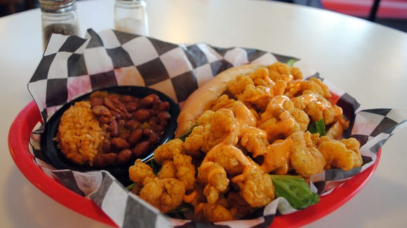 Hordes of people head to Seafood Bistro to spoil themselves by feasting on the famous Shrimp Po'Boy.