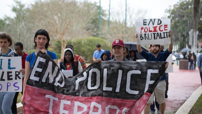 A rally to end police militarization.