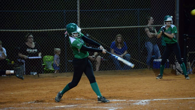Madi Thiele hits one of two doubles scoring 5 RBI on Tuesday, March 10, against rival Riverdale. The Green Wave won 9-2.