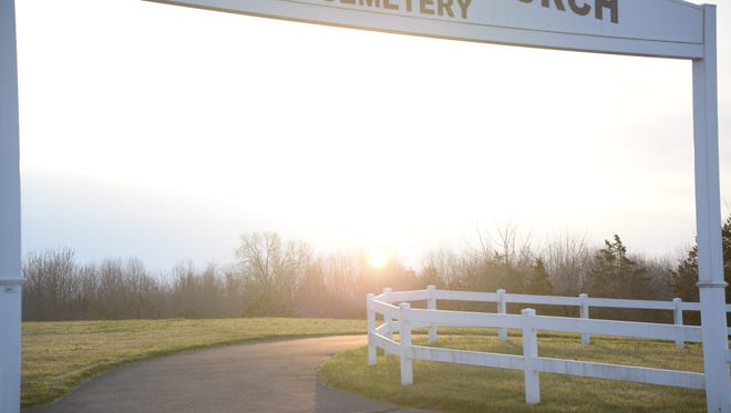 The sun rises above the Spring Hill Presbyterian Church's cemetery just outside of Staunton on Easter Sunday, April 5, 2015.