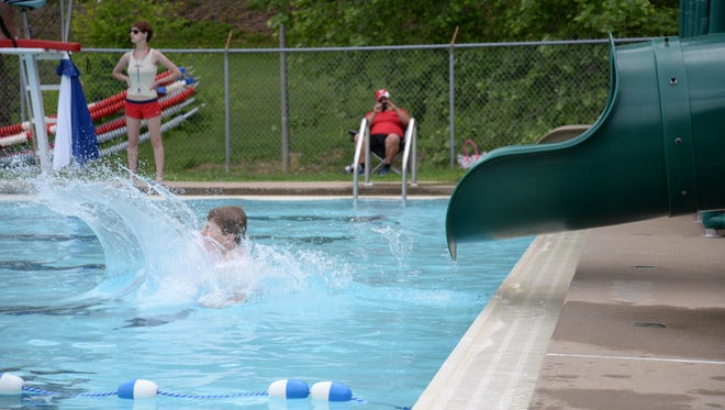 A child slides down the new slides during Memorial Day in 2014 at the Gypsy Hill Park Pool.