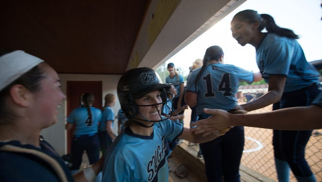 Enka senior Jasmine Palmer celebrates with her teammates after a home run in last week's 3-A Western Regional championship series.