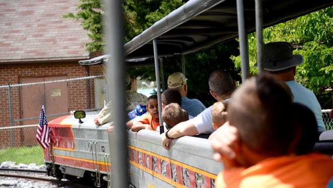 Passengers aboard the Gypsy Hill Express on Sunday, June 21, 2015.