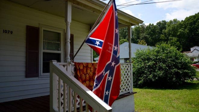 A Confederate flag hangs in front of Kiram Robertson's home in Stuarts Draft.