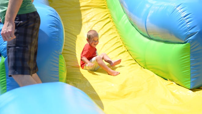 Children have fun during GraceBuilt Church's Sunday Summer Splash event commemorating a new building that will house the church.