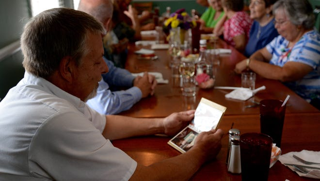 Jeff Norder looks at old photos of Brooks Restaurant during a small reunion in Staunton on Wednesday, August 19, 2015.