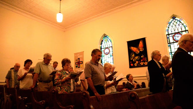 The congregation gathers for holy communion at St. Peter's Lutheran Church in Churchville for its 225th anniversary on Sunday, Aug. 23, 2015.