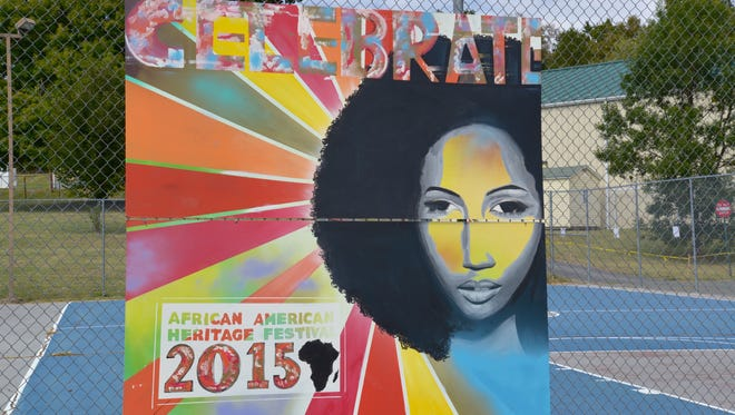 A painted mural by Sarah Jones for the 27th annual African American Heritage Festival at Gypsy Hill Park on Sunday, Sept. 20, 2015.