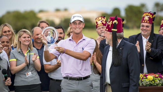 Smylie Kaufman holds the trophy after winning the Shriners Hospitals for Children Open at TPC Summerlin at on Sunday. Kaufman had to wait for two hours after finishing his round and watch as his rivals fell short. Oct 25, 2015; Las Vegas, NV, USA; Smylie Kaufman holds the trophy after winning the Shriners Hospitals for Children Open at TPC Summerlin at TPC Summerlin. Mandatory Credit: Joshua Dahl-USA TODAY Sports