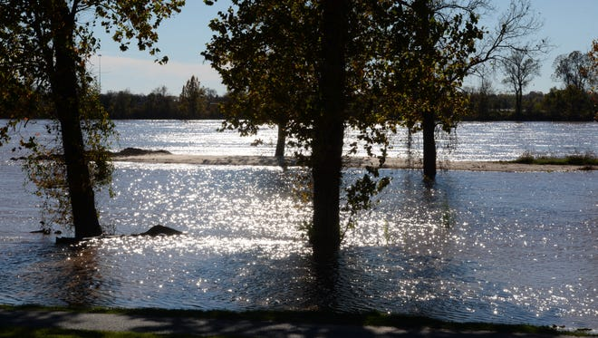 Water from Red River has risen to many of the walking trails at Arthur Ray Teague Parkway.