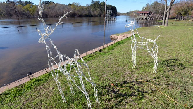 Holiday decorations at Logan's Ferry in Logansport look out onto the Sabine River as it now covers the river access parking lot.