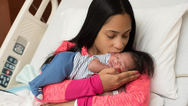Charisma Grandberry, 26, welcomes her son Mason Dallas Stewart, the first baby born in metro Detroit in 2016. Mason was born at 12:03 a.m. Friday at the Karmanos Family Birth Center at Beaumont Hospital-Royal Oak.