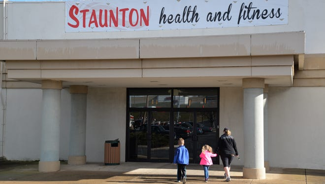 A family walks into Staunton Health and Fitness on Sunday, Jan. 10. 2016. CrossFit Staunton and Staunton Health and Fitness just a few hundred feet from each other at the Staunton Mall. The owners of CrossFit Staunton purchased Staunton Health and Fitness on Christmas Day in 2015.