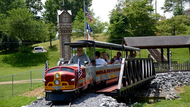 The Gypsy Hill Express gives visitors a ride Sunday. Passengers aboard the Gypsy Hill Express on Sunday, June 21, 2015.