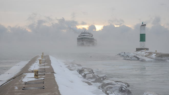 The Wilfred Sykes emerges from the fog on its way to Bay Shipbuilding Co. on Wednesday.