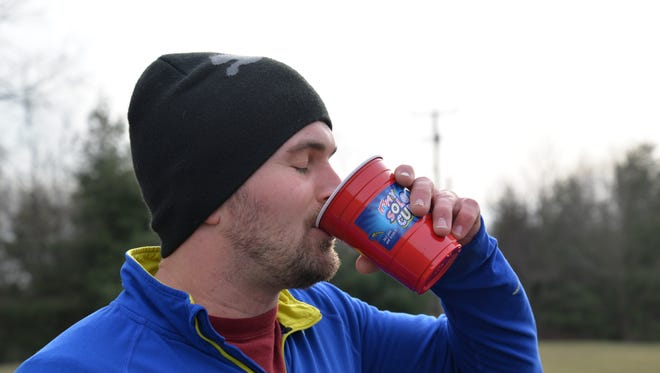 Miles Goodloe lost a bet with a friend, which meant he had to do the Beer Mile. His friend, Tony Robinson, picked the four beers he'd chug each lap.