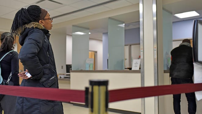 Deona Anderson,28, of Millville, a junior, waiting in line to pay her tuition at Cumberland County College in Vineland.  Feb. 18, 2016
