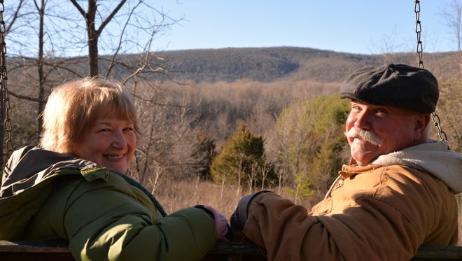 Diana and Ken Brasfield sit at one of their favorite spots on the Middlebrook tree farm.