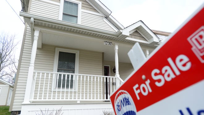 A home for sale on West Allegan Street in Lansing on Monday, April 11, 2016.