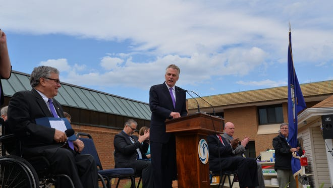 Gov. Terry McAuliffe addresses recent graduates of a Woodrow Wilson Workforce and Rehabilitation Center program, which partnered with CVS Health on Monday, April 11, 2016. The program trains young adults with disabilities skills to work at CVS Pharmacy locations.
