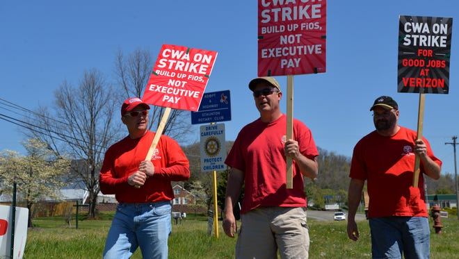 Three Verizon employees picket in front of the Verizon building off U.S. 11 on Monday, April 18, 2016. From left to right: Joedy Drulia, Joe Whitehead and Mike Grenz.