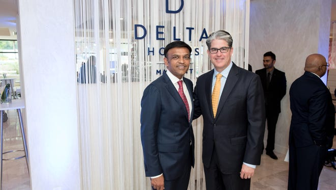 DJ Rama, president of Greenville-based JHM Hotels, with Paul Cahill, global brand jeader, Delta Hotels & Resorts.