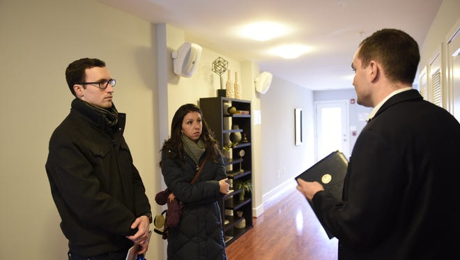 David and Elizabeth Glidden talk with Tim Savoy while touring a home in Washington, D.C.
