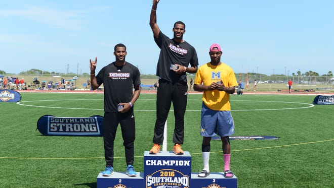 Emmanuel (middle) and Aaron Williams celebrate their 1-2 finish in the long jump at the Southland Conference Championships.