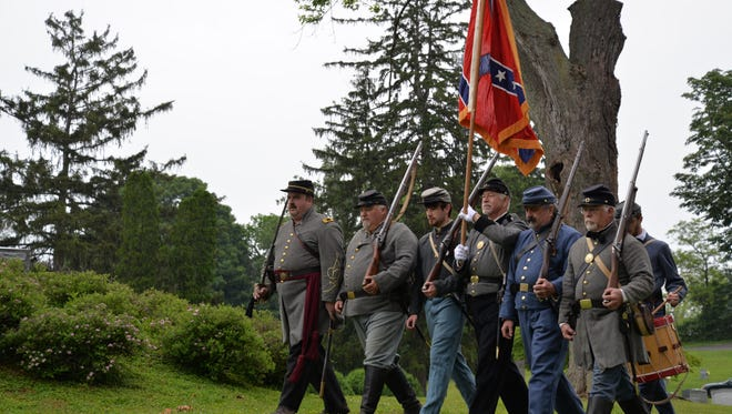 Confederate regiments present the colors at the annual Confederate Memorial Service at Thornrose Cemetery in Staunton on Sunday, May 29, 2016.