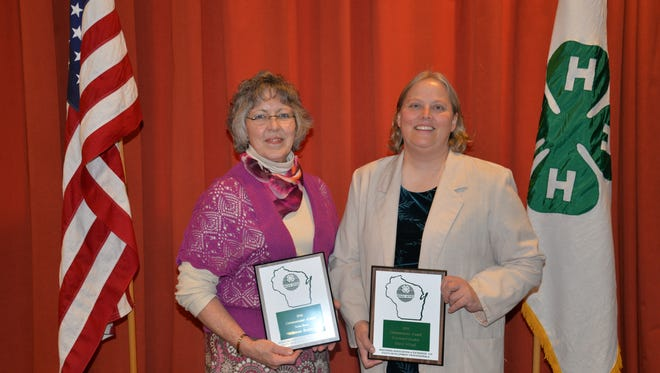 Bonnie Borden, Dodge County UW-Extension youth dairy & livestock educator, left, and Marie Witzel, Dodge County UW-Extension 4-H youth development educator pose with their awards.