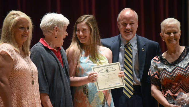 Hannah Mixon of Vancleave takes a moment with Department President Anita McAllister of the American Legion Auxiliary Girls State graduation on Friday in Southern Miss' Bennett Auditorium.