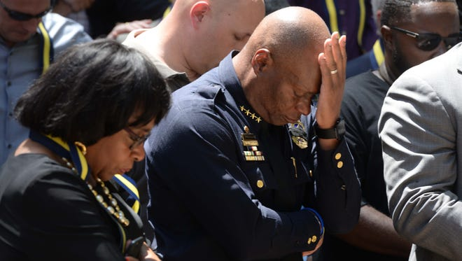 Dallas Police Chief David Brown bows his head during a multi-faith unity prayer service at Thanks Giving Square Friday afternoon.