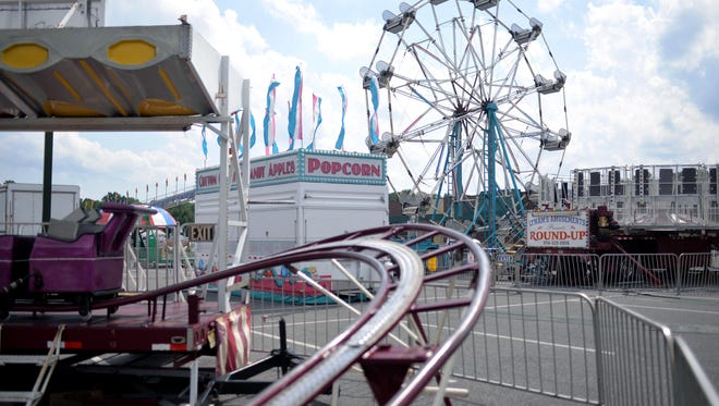Carnival equipment occupies part of the parking lot in front of Step of Faith Worship Center Monday,  Jul. 18, 2016 in Vineland.  The church will hold the carnival from Wednesday to Saturday this week in the Lincoln and Landis Avenues parking lot it shares with ShopRite.